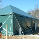 30×40 Celebration tent used as a permanent housing facility