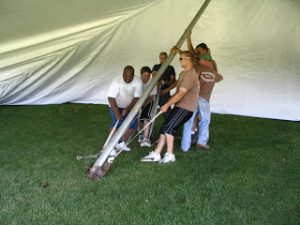 Armbruster's team installs a EuroTent for an Easter Seals event in Peoria