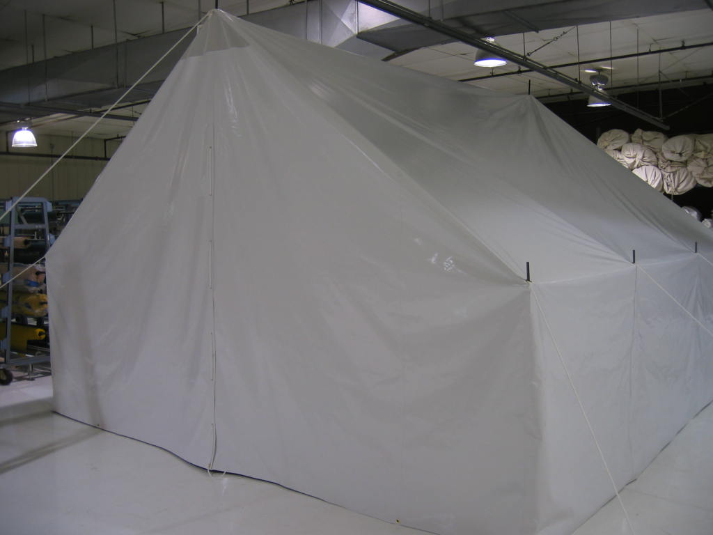Haiti disaster relief tent, exterior with doors folded shut. Designed to be water resistant with no stitching and a continuous RF Welded membrane of heavy duty 14oz vinyl.