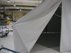 Haiti disaster relief tent. Both ends can be folded up for ventilation and access.