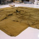 The Tri-State Living History Association loaned Armbruster two original 1934 Pyramidal Tents, World War II Canvas, to reference in our reproductions. The early war USMC khaki version is laid out on the factory floor to compare with our original specs.