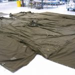 The Tri-State Living History Association loaned Armbruster two original 1934 Pyramidal Tents, World War II Canvas, to reference in our reproductions. The Mid-War Army Contract version is laid out on the Armbruster floor to compare with our original specs.
