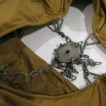 Detail View of the Chain and Plate Assembly for the Original USMC Khaki Original Pyramidal World War II Tent loaned to Armbruster.