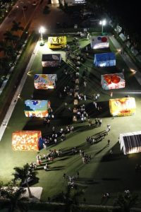 Disaster Relief Tents: Base Tent Gift of Painted Tents for the Children of Haiti. Armbruster tents painted by artists and donated as classrooms following the Earthquake in Haiti. Night view during ArtBasel, Miami.
