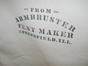 Armbruster's has been making tents in America since 1875. A historical tent used for the Lone Ranger Movie is inscribed with our original stenciled logo from 1875.