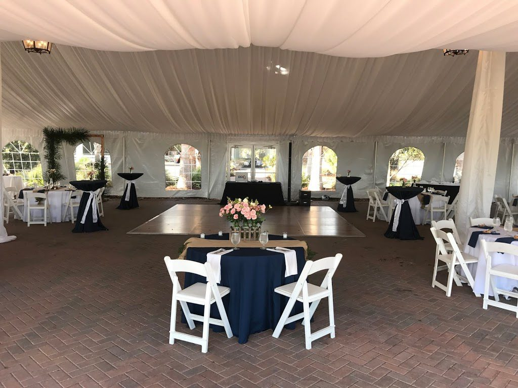 Interior of 50ft x 80ft EuroTent on the South Carolina Coast with Liners and Place Settings for Wedding