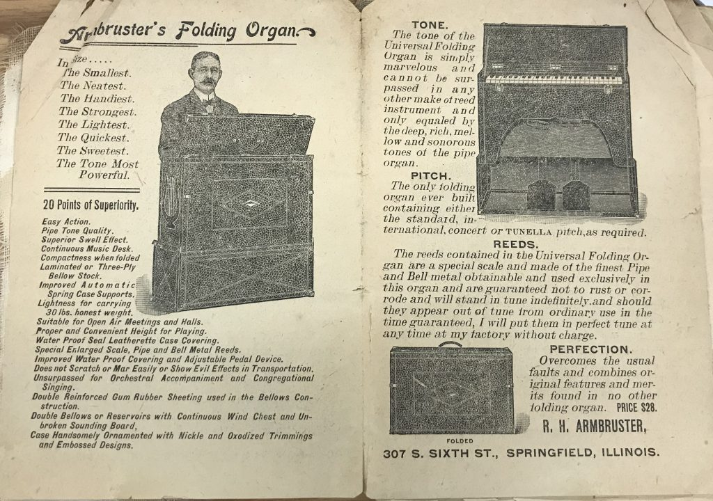 Page from 1903's The Complete Campers Manual advertising Armbruster's line of folding organs