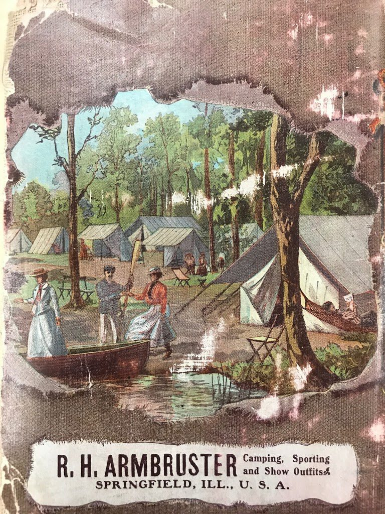 Back inside cover of The Complete Campers Manual featuring a beautiful color engraving showing early 20th century camping life.