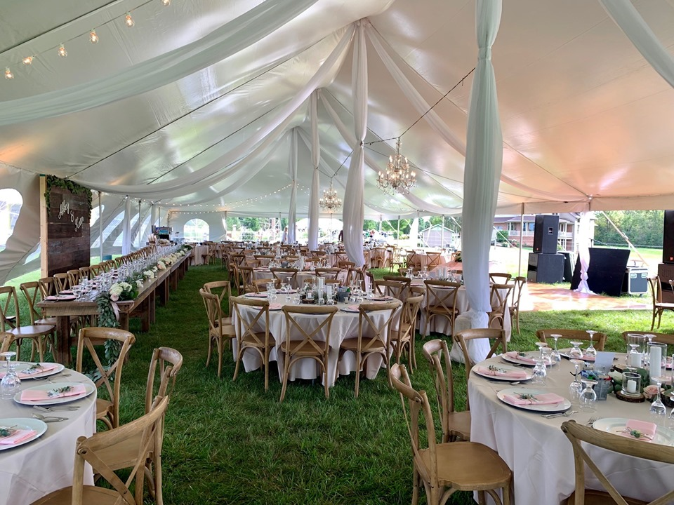 Interior shot of a beautiful outdoor wedding that was held in Taylor Ridge, Illinois. The reception was held under an Armbruster EuroTent.
