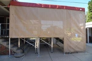 Side view view of custom cover created to protect an ADA accessible ramp and elevator system on a home in Chicago.