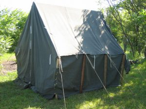 Armbruster World War II Small Wall Tent with sides down. Our tents are secure and built to be rainproof.