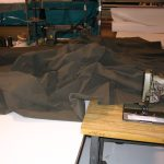 Period canvas being sewn with 1940s cotton thread for a historical Armbruster World War II tent.