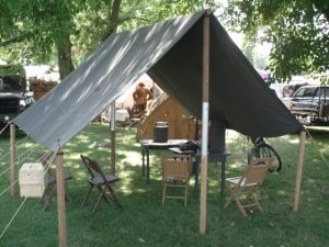 World War II Tent Fly with extra corner posts to stretch it further