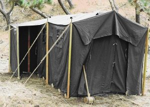 CW4 Bundgaard demonstrating proper installation, 1942 World War II (WWII) Command Post Tent