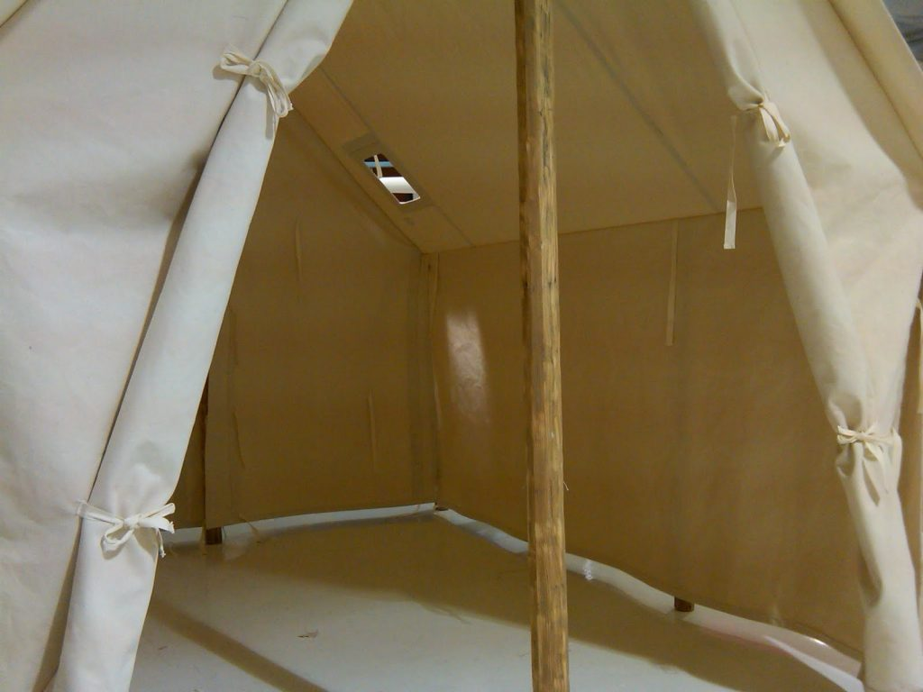 Custom Outfitter Canvas Tent for Store Display in Montana, Interior with Wood Poles