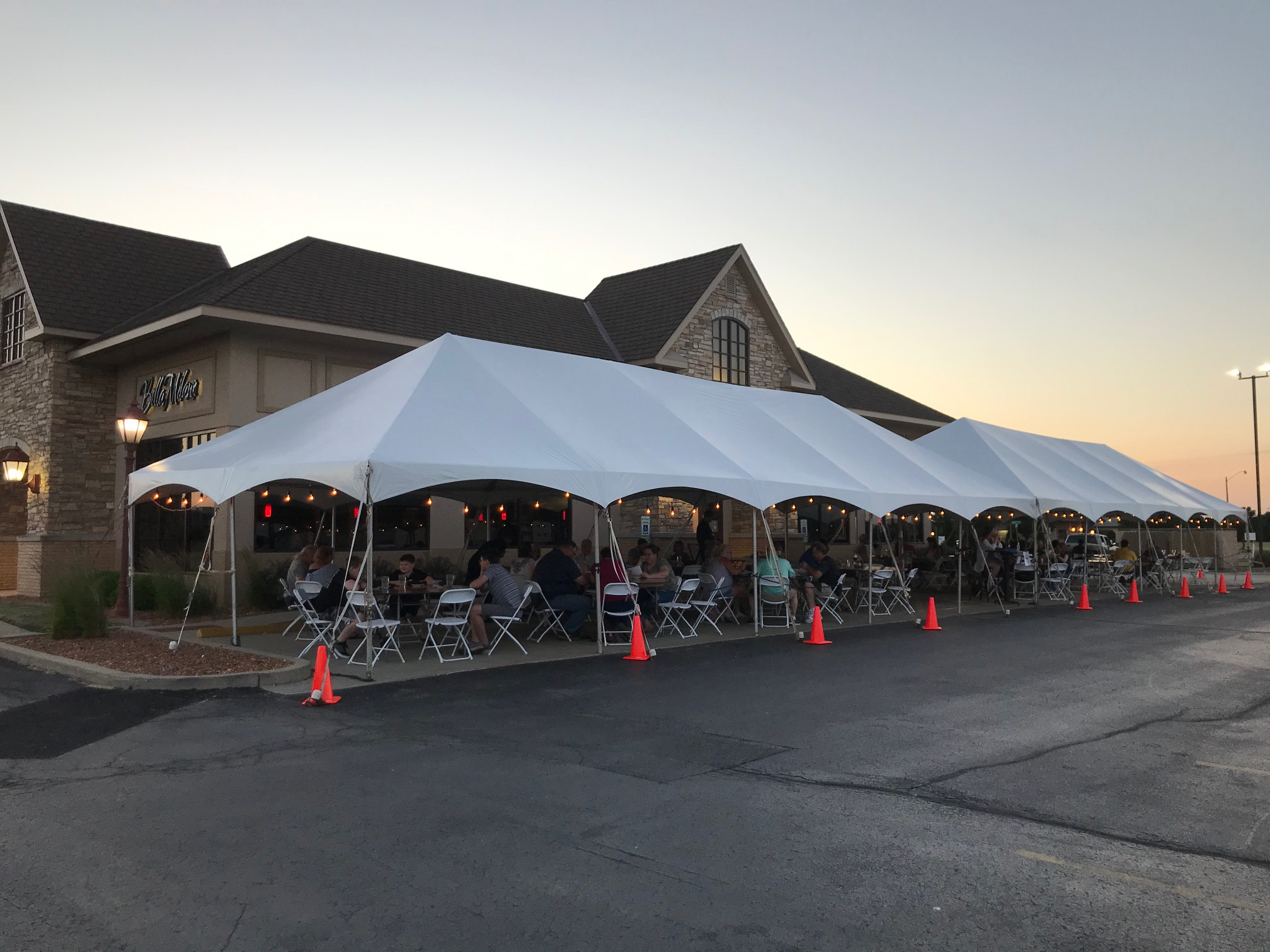 Bella Milano Celebration Frame Tent Provides Patio Dining During COVID-19. 2 tents installed for more seating.